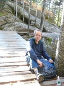 Jeff resting on Katahdin Stream Falls bridge